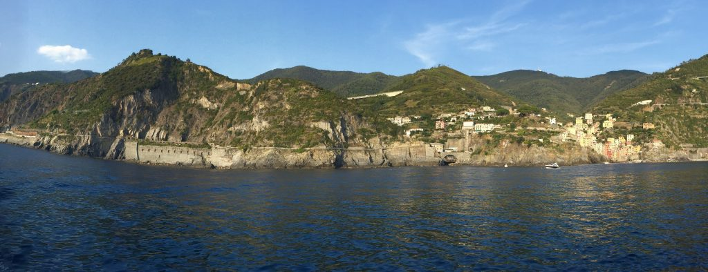 Here are the two mountains as seen from the sea.  I came in on the right and over the hill through town on the right only to note the Higher double-peaked hill to the left!  It was my goal to end up in Manarola which you can see on the far left beyond the Via del Amore path.